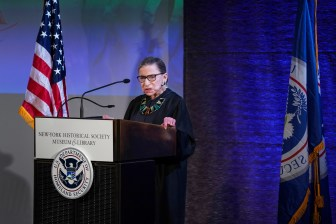 Justice Ruth Bader Ginsburg '54 speaks at an event in New York, April 9, 2018. In the last decades of her life, Ginsburg maintained a full schedule while battling cancer five times.