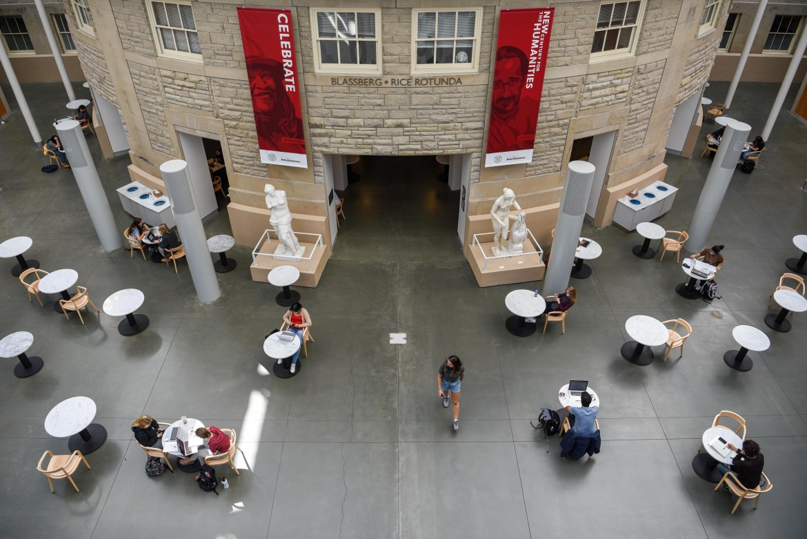 Students enter Temple of Zeus clad in masks and sit at most two to a table, but still enjoy using the space to study and work between classes.