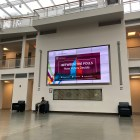 "The Klarman Hall screen advertises Monday's ""Between the Polls"" event. Just over two weeks before the election, a panel of government professors and The New York Times national editor examined polls, votes and election trends."