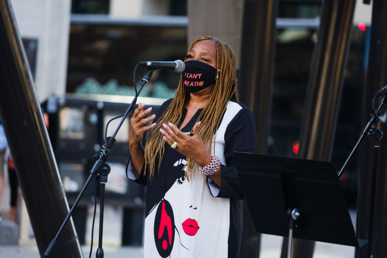 """Phoebe Brown, Central New York coordinator for the human rights group Families for Justice Alliance, speaks during the """"Protect the Ballot Count"""" rally."""
