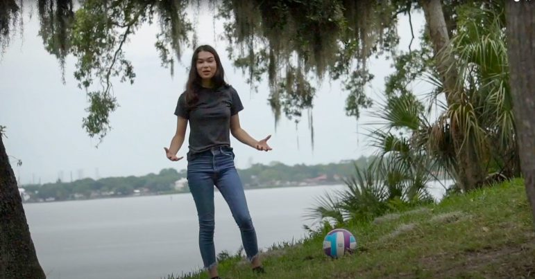 Jannereth stands next to a ball in her video entry for the Breakthrough Junior Challenge.