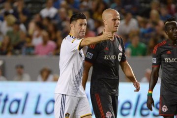 LA Galaxy's Robbie Keane talks to TFC's Michael Bradley