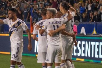 Giancarlo Gonzalez celebrates with LA Galaxy teammates on July 4, 2019 -- Photo by Brittany Campbell