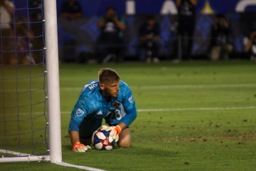 Matt Lampson makes a save for the LA Galaxy in a game on July 23, 2019 - Photo by Brittany Campbell