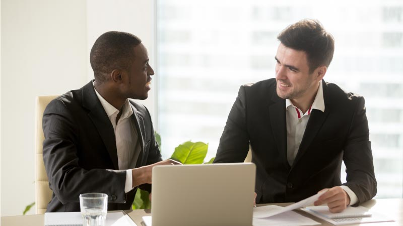 two men consulting on benefits for employees