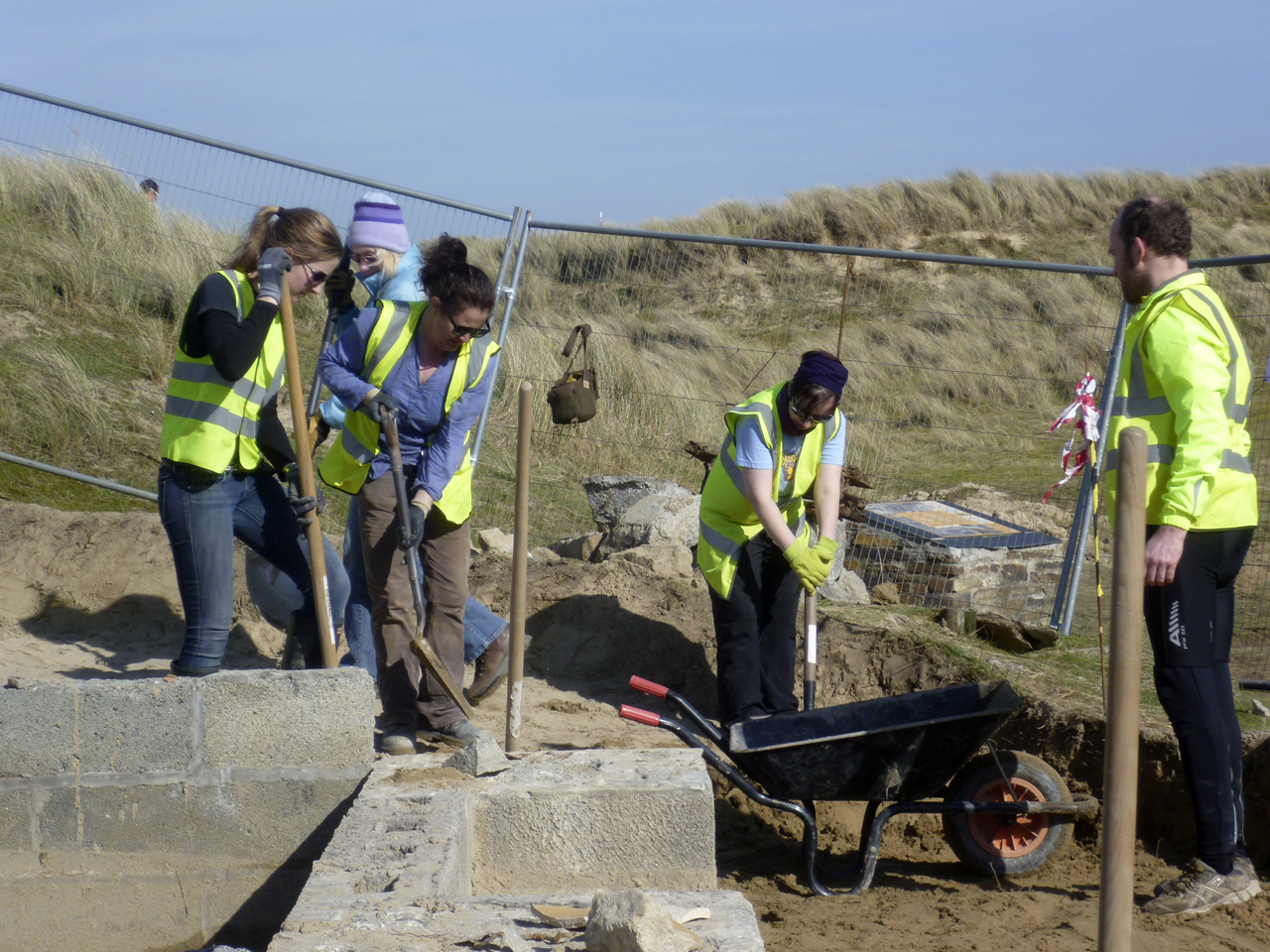 CAS members dig out the sand from St Piran's Oratory