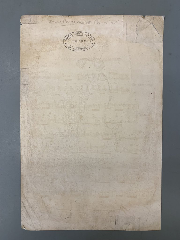 Sheet of paper with a stamp saying Royal Institution of Cornwall, Truro, showing faint markings of piano sheet music.