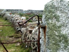 Stone walls and rusty gate