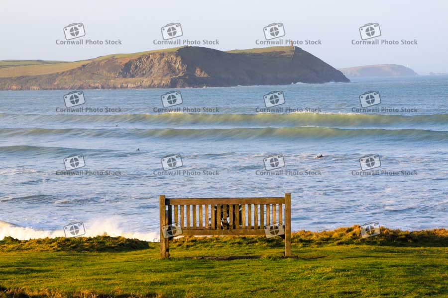 Peaking waves rolling into Polzeath beach with Stepper Point, Cornwall in the background