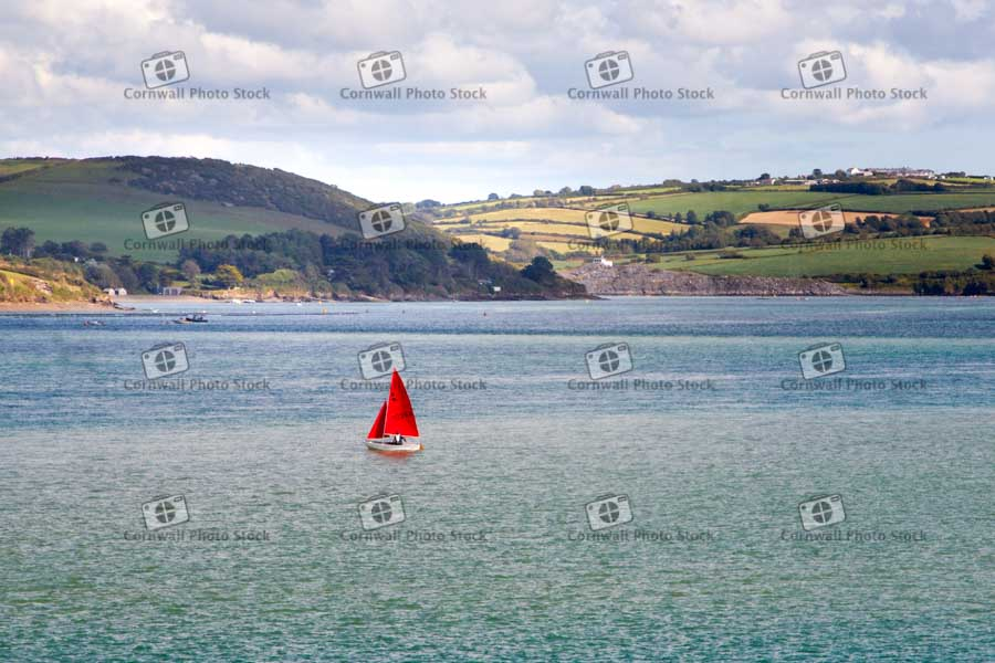 Sailing Dinghy With Red Sails On The Camel Estuary