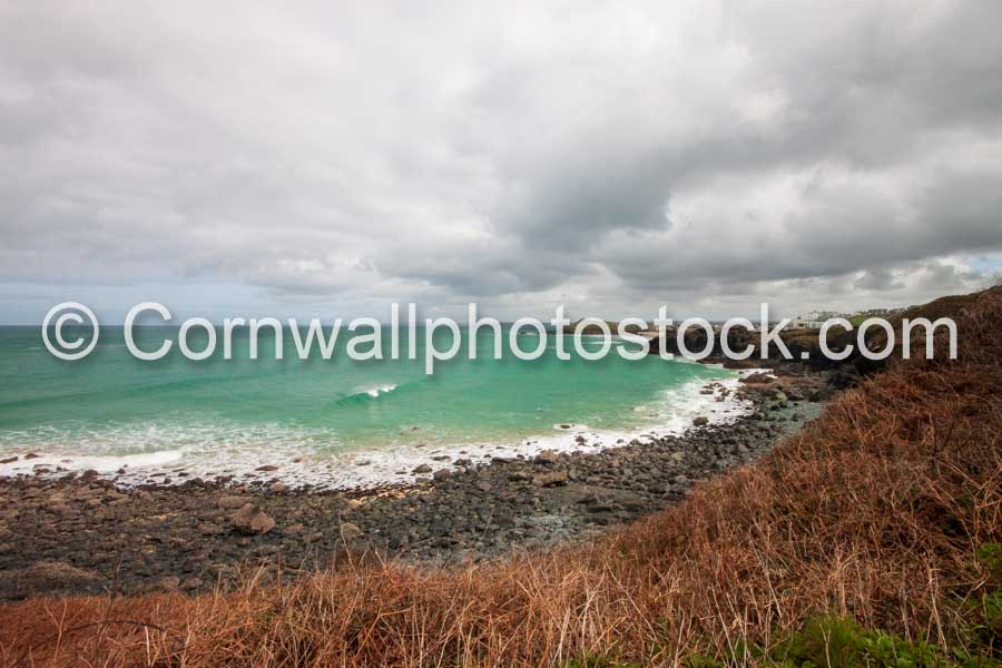 Rocky Bay With Breaking Wave And St Ives Head In Distance