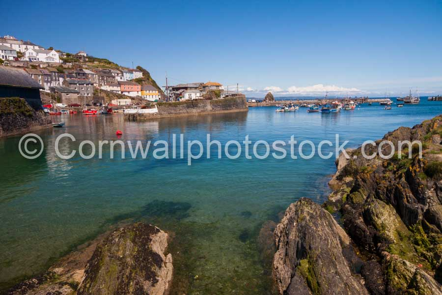 Mevagissey Harbour With Rocks In Foreground