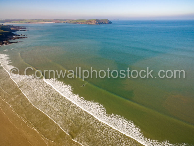 Clean Lines Arrive At Polzeath With Stepper Point In Background