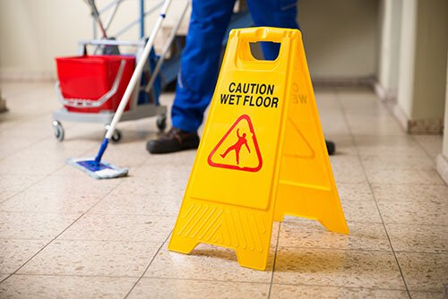 Custodian Mopping Floor