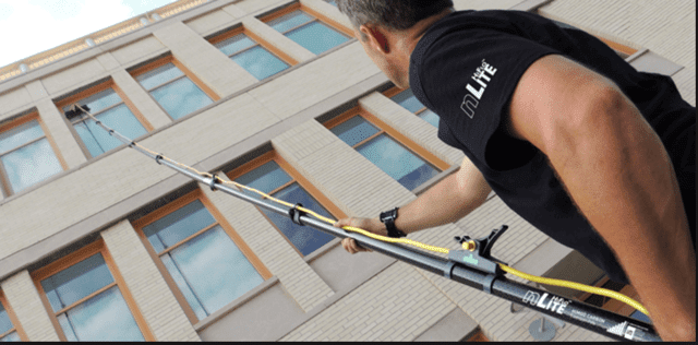 Window Cleaning Equipment Reaching High Building Window