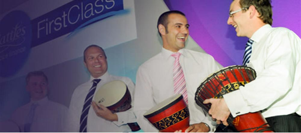 Men enjoying a drum session - Business Applications