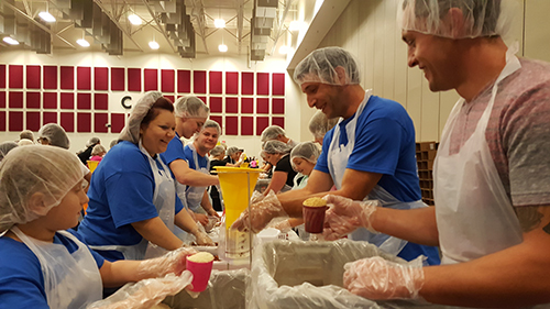 Employees volunteer at Make a Million Meals event in Springfield., MO