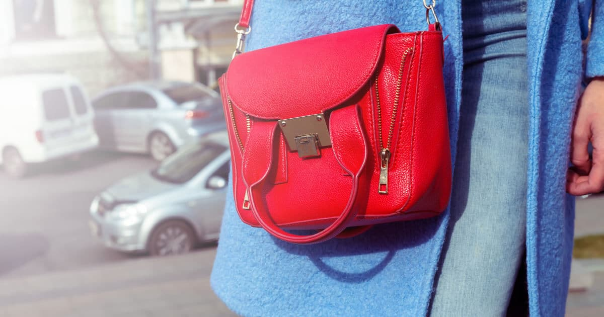 is dressing better than your boss a bad idea? great business etiquette question - image of a designer red bag