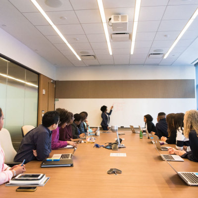 stock photo of a filled conference room watching a presentation