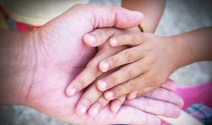 hands of grandchildren and grandparent