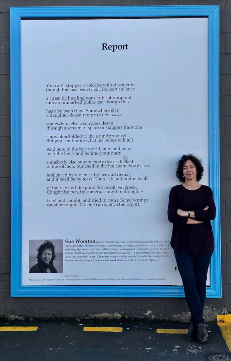 """Sue Wootton with her """"Report"""" on a super Phantom Billstickers Poem Poster on King St, Ōtepoti"""
