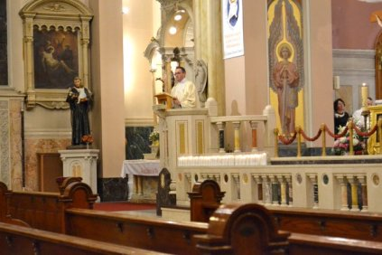 Here Fr. General delivers a sermon during Mass.