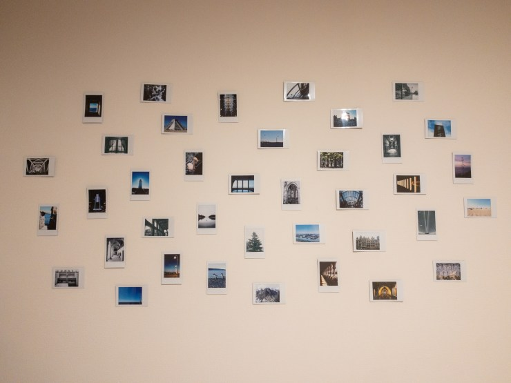 A mural of 38 Instax film pictures. Each one of them was taken in a different city.