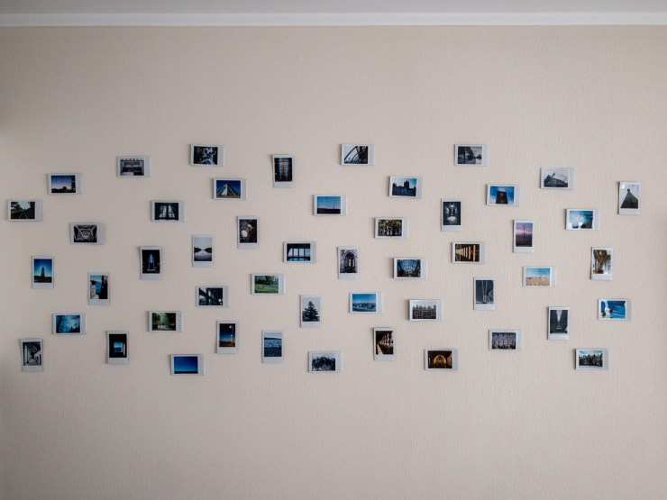 A mural with 50 Instax film pics, all taken in different cities of the world.