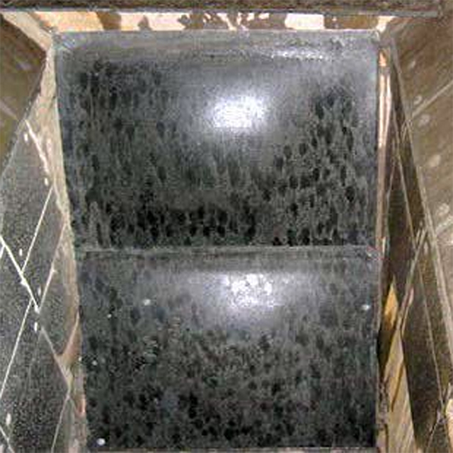 Image of a DynaVibe rubber inflatable wear liner. These liners from Corrosion Engineering eliminate material buildup and plugging in mining chutes and bulk material handling transfer applications.