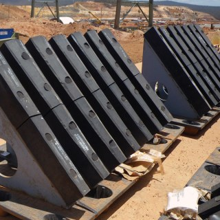 Corrosion Engineering Grizzly Bars staged for installation at a large iron ore mine.