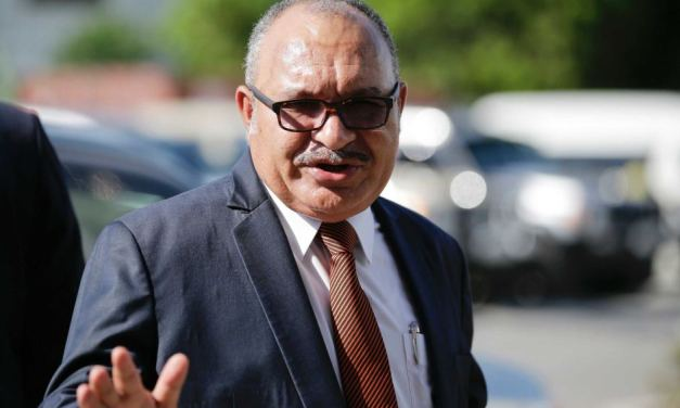 PNG: Former Prime Minister issued arrest warrant.