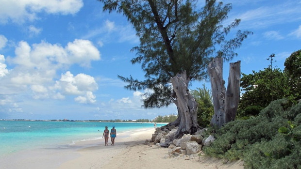 In addition to the beautiful beaches, the Cayman Islands are known as a 'tax neutral jurisdiction,' where foreign companies pay no tax. (David McFadden/Associated Press)