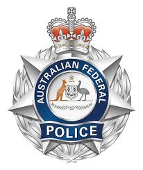 Australia:  A Federal Police officer was charged with corruption