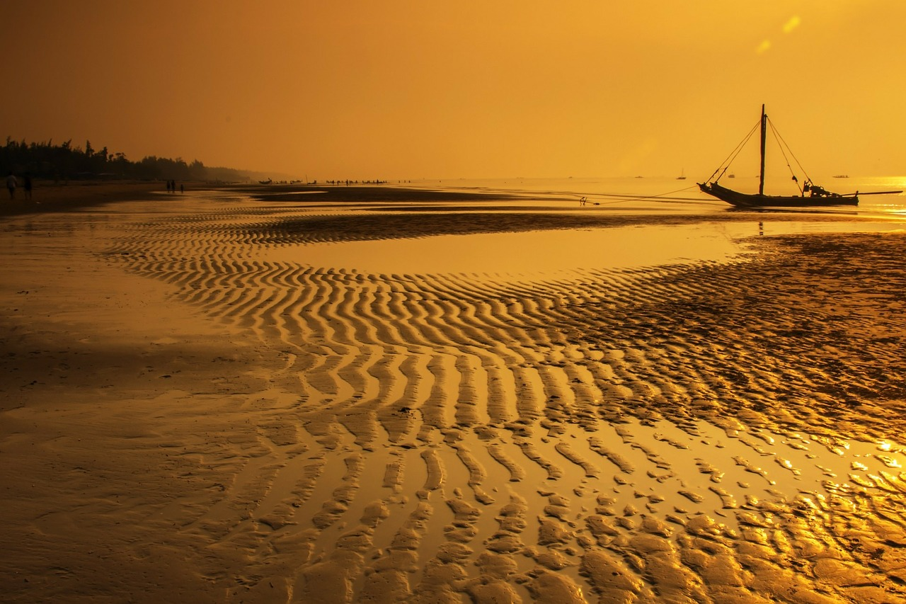 Small fishing boat drawn up on beach