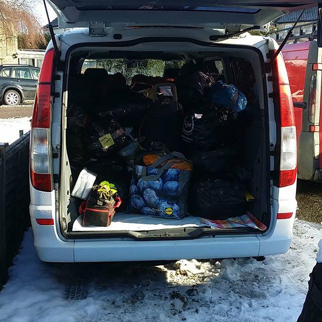 Rear door of van open to show all the supplies going to Oasis