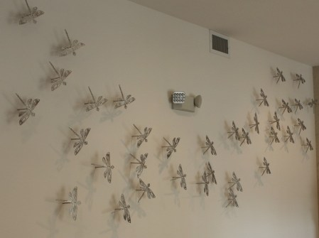 "Xavier Cortada, ""Los Caballitos del Diablo,"" brushed aluminum cut-outs, 2014."