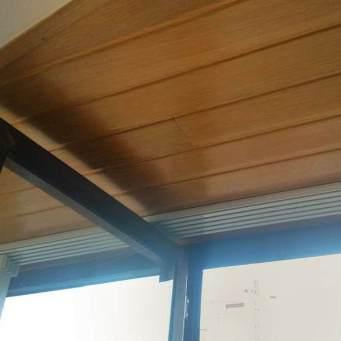 Apertura ventanas con paneles deslizantes en esquina para mirador, detalle