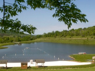 An overview of Hope Lake in Virgil is shown with its newly installed white sand beach Tuesday.