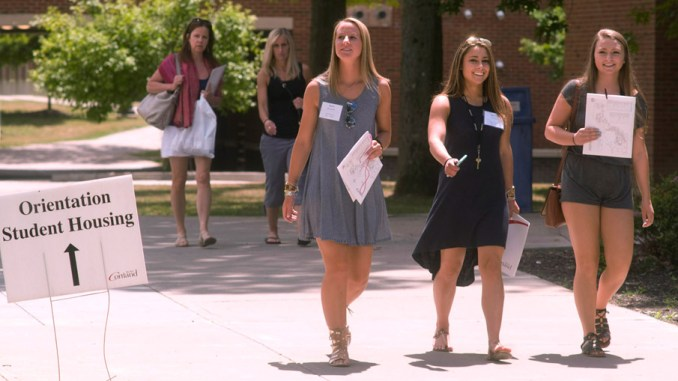 Incoming students and their mothers walk the SUNY Cortland campus Thursday during orientation activities. The students are, left to right, Kaitlin McGovern, Joanna D'Amico and Abigail Cerio. Following them are two of their mothers, Christine D'Amico, left, and Christine McGovern. The incoming students' day was filled with tours of campus buildings, lectures and a range of activities. It's the second of four weeks of orientation for groups of new students.