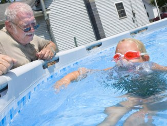 Daryl Reynolds, of Cortland, maintains a medium-sized backyard pool Wednesday for his granddaughter Chloe Fisher, 6, also of Cortland. Virtually all of Cortland County is in moderate or severe drought, according to the National Drought Mitigation Center.