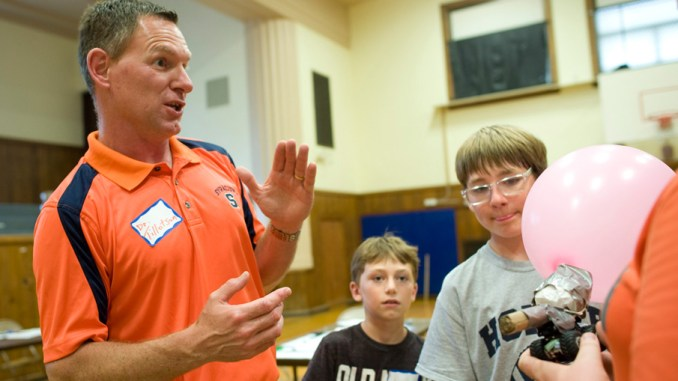 John Tillotson of Syracuse University's Department of Science Teaching, talks with Truxton youths Aidan Sonnacchio, 10, center, and Jack Smith, 12, during a teaching program Friday at Truxton Community Center.
