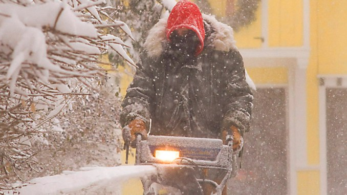 Patrick Clune uses a snowblower to clear his driveway on North Main Street in Homer in this Dec. 10, 2012, file photo. The Old Farmer's Almanac is predicting a colder than normal November, followed by a warmer-than-normal December and an uncertain January.