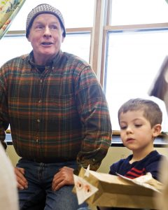 Joe McIntyre/staff photographer Peter Harrity teaches 3-year-old Sam Smith, a pupil with the Cortland Child Development Center, about owls at Lime Hollow Nature Center in this file photo.