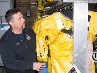 firefighters observes safety suit