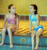 Little Girls chatting at pool