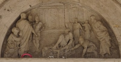 The death of Saint Lawrence (San Lorenzo); lunette above the main entrance.