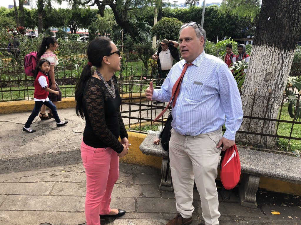 Lesly Tayes, a Guatemalan human rights lawyer and Lee Gelernt, lead ACLU lawyer, are part of an effort to reunite parents in Guatemala with their kids still being held in the U.S. They are standing in the central park in Chimaltenango, a town about two hours west of Guatemala City, Guatemala. Alternative text courtesy of NPR.