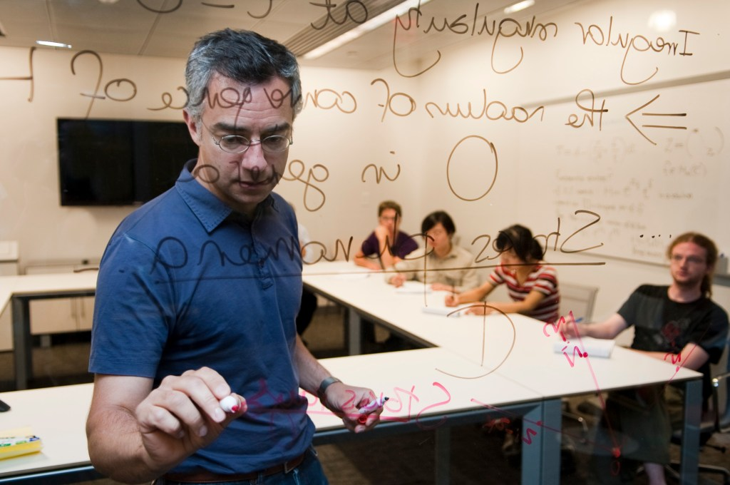 Mathematics Professor Toledano Laredo writes on a glass wall.