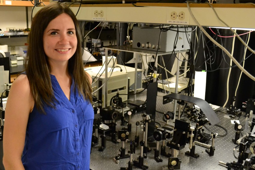 Bridget Salna, physics PhD student, stands in a lab