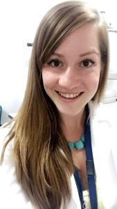 Kelsey Jordan wearing a white doctor's coat